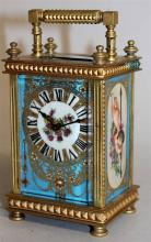 A BRASS CARRIAGE CLOCK with painted Sevres type pa