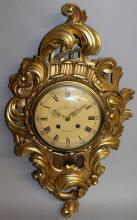 A GOOD CARVED AND GILDED CARTEL CLOCK by Em. Soder