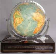 A COLUMBUS DIO AARD GLOBE, on a wooden stand.