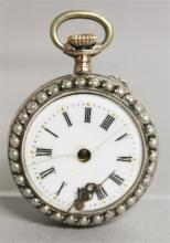 A LADIES SILVER POCKET WATCH with reverse pug dog.