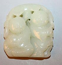 A CHINESE CELADON JADE-LIKE CARVING OF TWO BOYS, e