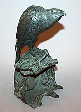 A JAPANESE MEIJI PERIOD PATINATED BRONZE MODEL OF
