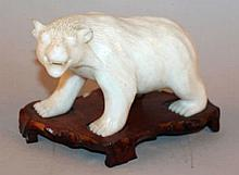 A CHINESE CARVED MARBLE MODEL OF A BEAR, together