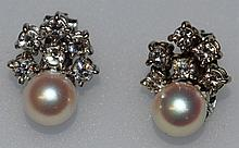 A VERY GOOD PAIR OF DIAMOND AND PEARL CLIP EARRINGS in 18k w