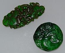 TWO CARVED JADE PENDANTS.