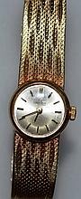 A LADIES 9CT GOLD OMEGA WRISTWATCH.