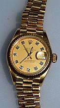 A LADIES GOLD DIAMOND ROLEX WRISTWATCH in box.