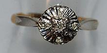 AN 18CT YELLOW GOLD PLATINUM DIAMOND SET CLUSTER RING.