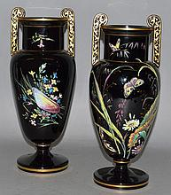 A GOOD PAIR OF VICTORIAN BLACK GLASS TWO HANDLED URNS painte