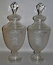 A LARGE PAIR OF CUT GLASS URN SHAPED VASES AND COVERS.  25in
