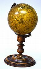 A NEWTON'S 3-INCH MINIATURE TERRESTRIAL GLOBE ON A STAND, 5.