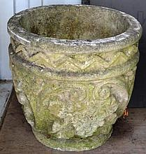 A PAIR OF RECONSTITUTED STONE CIRCULAR URNS with moulded dec