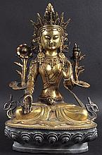 AN EARLY 20TH CENTURY SINO TIBETAN BRONZE FIGURE