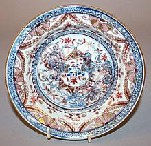 AN 18TH CENTURY CHINESE CLOBBERED PORCELAIN DISH