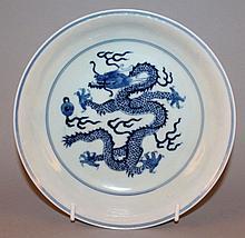 A CHINESE BLUE & WHITE PORCELAIN DRAGON DISH