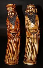A PAIR OF EARLY 20TH CENTURY CHINESE STAINED IVORY FIGURES OF LAUGHING DEITIES