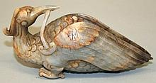 A 20TH CENTURY CHINESE JADE LIKE CARVING OF A MYTHICAL BIRD