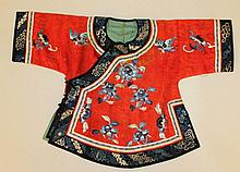 A 19TH/20TH CENTURY CHINESE RED-GROUND EMBROIDERED SILK CHILD'S JACKET