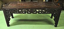 A 19TH CENTURY CHINESE PROVINCIAL CARVED HARDWOOD TABLE with carved undertier. 7ft 5ins x 1ft 2ins.