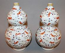 A PAIR OF CHINESE FAMILLE ROSE & IRON-RED DOUBLE-GOURD PORCELAIN VASES