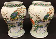 AN UNUSUAL PAIR OF 18TH CENTURY CHINESE FAMILLE ROSE PORCELAIN VASES