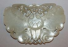 A CHINESE CARVED CELADON GREEN JADE PENDANT OF A BUTTERFLY