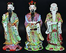 A SET OF THREE 20TH CENTURY CHINESE PORCELAIN FIGURES OF THE FU
