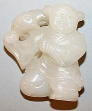 A 19TH CENTURY CHINESE WHITE CELADON JADE CARVING OF A KNEELING BOY