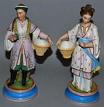 A PAIR OF 19TH CENTURY BISQUE CHINESE FIGURES OF A
