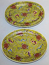 A PAIR OF CHINESE FAMILLE ROSE OVAL DISHES, 8.2in