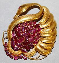 AN 18CT YELLOW GOLD AND RUBY SWAN BROOCH.