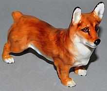 A ROYAL DOULTON MODEL OF A STANDING CORGI.