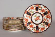 A SET OF TWELVE ROYAL CROWN DERBY JAPAN PATTERNED PLATES. <br>Retailed by James Green and Nephew, London.  8.5ins diameter.