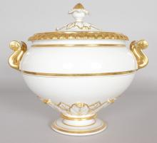 A LARGE WORCESTER TWO HANDLED CIRCULAR TUREEN AND COVER, white body with gilt decoration.