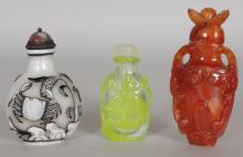 A GROUP OF THREE 20TH CENTURY CHINESE SNUFF BOTTLES & STOPPERS, one of agate, the two others of overlay glass, the taller agate bottle 3.25in high. (3)