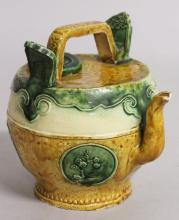A CHINESE POTTERY WINE EWER, the sides with green ovals of flowers.