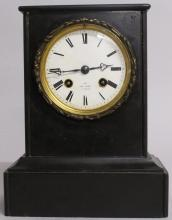 A SMALL 19TH CENTURY FRENCH BLACK MARBLE CLOCK by HENRY MARC, PARIS, with white dial and eight-day movement. <br>9ins high.