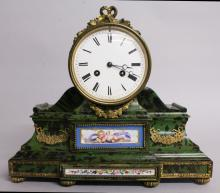 A LOUIS XVI DESIGN TORTOISESHELL MANTLE CLOCK with eight-day movement, ormolu mounts and painted Sevres porcelain panel. <br>12ins high.