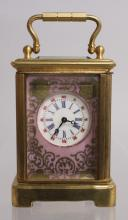 A MINIATURE PINK CARRIAGE CLOCK with SEVRES STYLE PANELS.