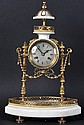 A FRENCH MARBLE AND GILT METAL CLOCK, with