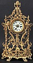 A 19TH CENTURY FRENCH CLOCK, in a pierced ormolu