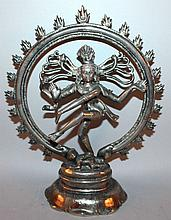 AN INDIAN SILVERED METAL MODEL OF SHIVA, dancing within an aureole of flames, su