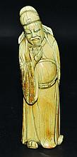 A CHINESE MING STYLE CARVED IVORY FIGURE OF A SCHOLAR, holding a cup to his mout