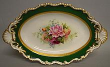 A ROYAL WORCESTER OVAL DISH painted with roses inside an acid etched inner borde