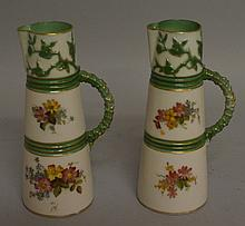 A ROYAL WORCESTER PAIR OF CLARET JUGS of unusually small size, painted with flow