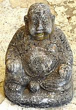 A RECONSTITUTED STONE GARDEN ORNAMENT modelled as a seated   Buddha.  15ins