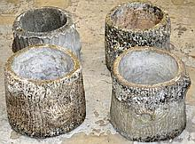 A SET OF FOUR RECONSTITUTED STONE PLANTERS modelled as tree   stumps.  11ins