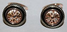 A PAIR OF STERLING SILVER ROSE FINISHED WHEELS CUFFLINKS.