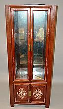 A CHINESE REDWOOD AND MOTHER-OF-PEARL INLAID STANDING CARVED CUPBOARD with mirro