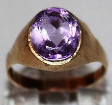 AN AMETHYST DRESS RING.